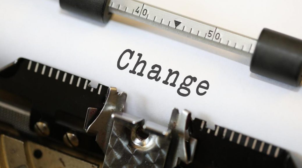 Text on a sheet of paper in a type-writer: Change